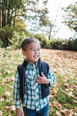 Happy Asian Kid Outdoor During Autumn Season
