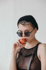 Stylish woman with apple