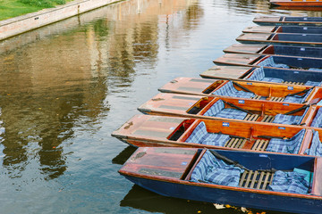 Punts lined up on the river in Cambridge, England.
