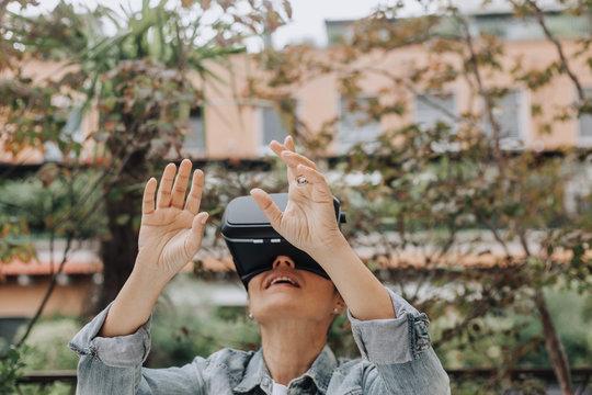 Woman using a 360 3D VR glasses