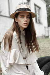 beautiful attractive girl in a hat