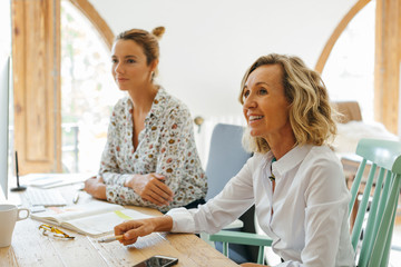 Female team working in a modern office.