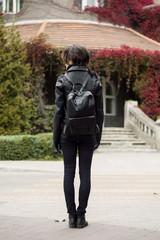 Stylish woman on autumn street