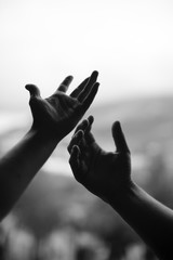 movement of two hands in black and white