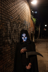 Grim Reaper Texting On The Phone