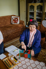 Female with down's syndrome having educational time at her home