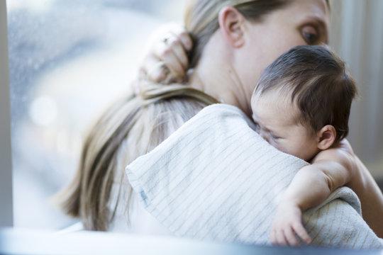 Baby resting on mother's shoulder