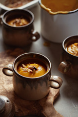 Butternut squash soup in stoneware bowls.
