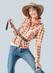 Fashion photo in country style of pretty young woman in cowboy hat