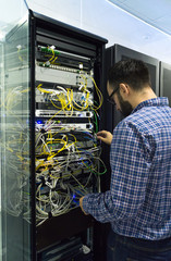 Technician performing maintenance tasks in a server of communica
