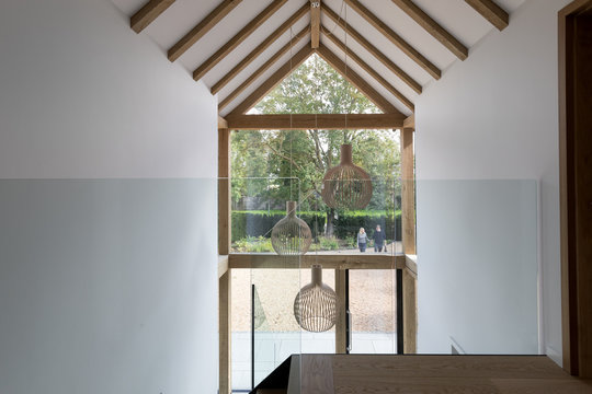 Looking out through all glass entrance from the first floor of a modern house.