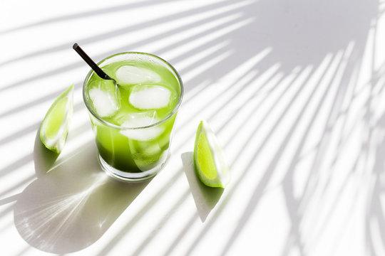 Matcha, green tea, ice tea in a glass Copy space.