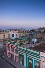 Overview of rooftops of buildings at dusk, Cienfuegos, Cuba, West Indies, Caribbean