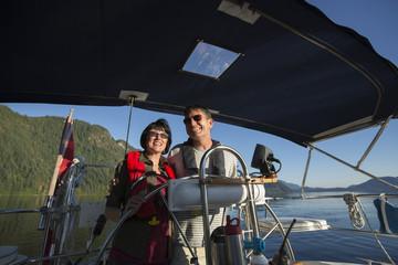 Close-up of couple sailing in Harmony Islands Park, Sunshine Coast, British Columbia, Canada