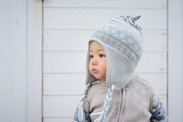 Baby Boy in Hat and Sweater Outdoors, Italy