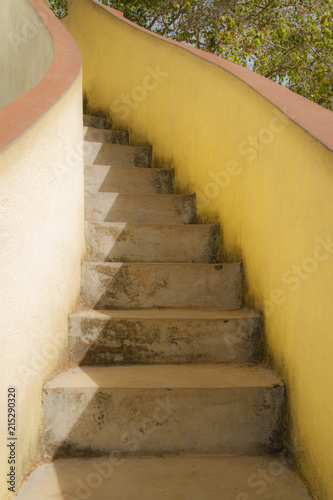 stairs with yellow walls in temple area wewurukannala vihara temple