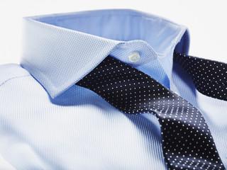Blue Shirt with Dark Blue Tie on White Background, Studio Shot