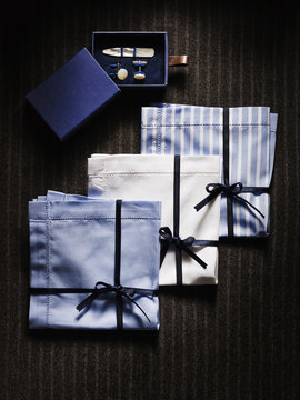 Overhead View of Box with Collar Stays and Cuff Links with Three Handkerchiefs