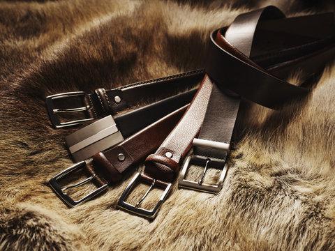 Five Leather Belts on Fur, Studio Shot