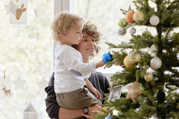 Mom and son admiring Christmas tree