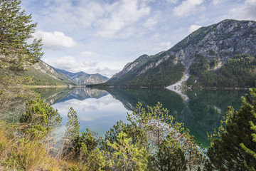 Landscape of a clear lake in autumn, Plansee, Tirol, Austria