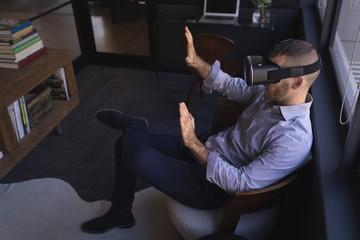 Businessman using virtual reality headset