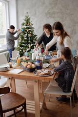 Family preparing for Christmas dinner