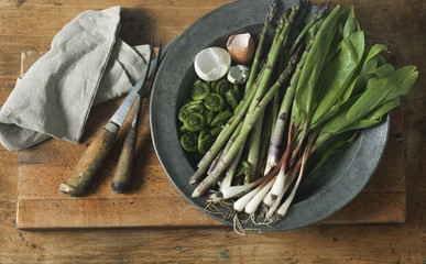 Overhead View of Asparagus, Fiddleheads, Wild Leeks and Egg Shells on Plate