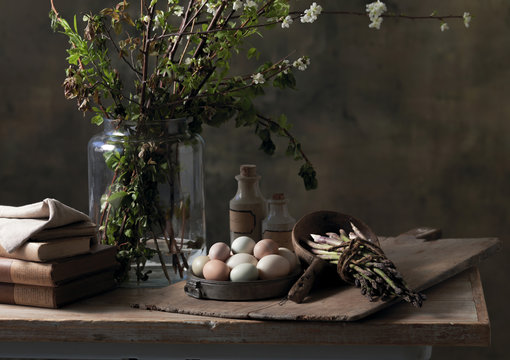 Still Life of eggs and asparagus on table