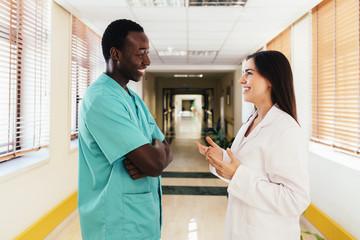 Couple of professional medics communicating