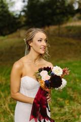 Portrait of Beautiful Bride holding Bouquet