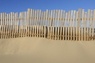 Sand Fence on beach on a sunny day near Cadiz in Cadiz Province in Costa De La Luz, Andalusia, Spain