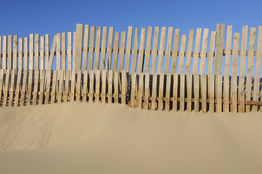 Wooden fence on beach