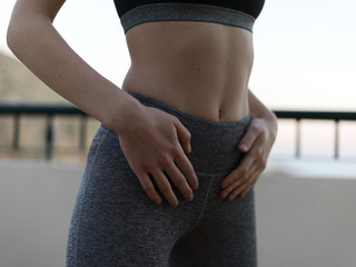 Belly of fit sporty woman