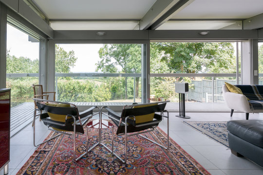 Two modern chrome chairs set in a contemporary sitting room.