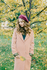 Romantic girl in autumnal coat