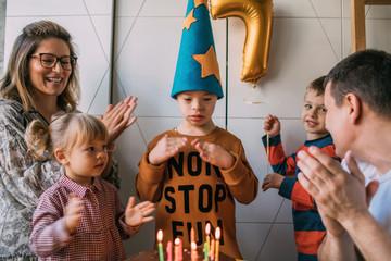 Happy family celebrating boy's birthday