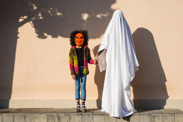 Girl in mask and ghost