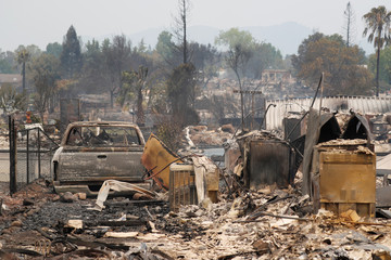 A charred neighborhood destroyed by the Carr Fire is seen west of Redding, California