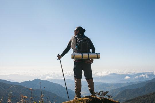 Mardi Himal Trek: A man taking a break and enjoying the view.