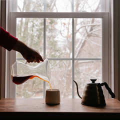 Man Pouring Fresh Hot Coffee