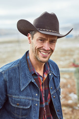 portrait of a cowboy smiling at camera