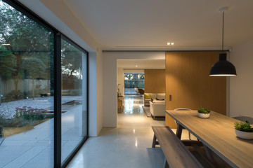 Evening picture through the interior of a modern house illuminated.