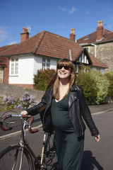 Pregnant with a bike.