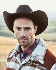 Cowboy portrait in a field