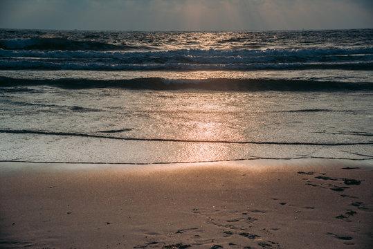 Seascape before sunrise on beach