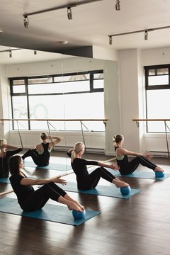 Group of women exercising on exercise mat
