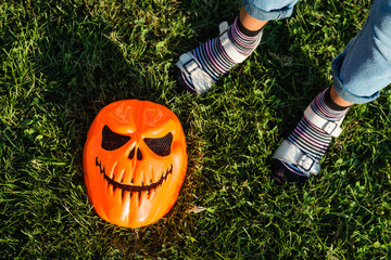 Legs of child and Halloween mask