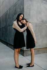 Two Women in Matching Outfits Posing Stoicly