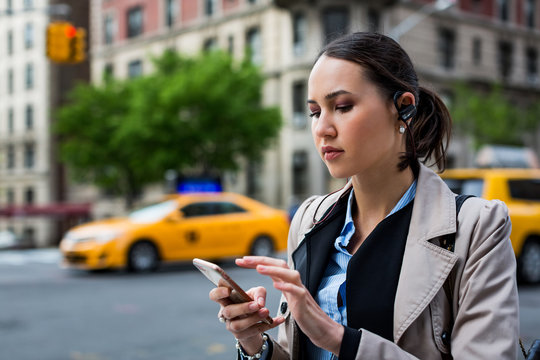 Businesswoman using technology outdoor in the city.  NY